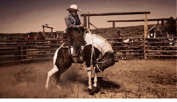 Myron Beck photo of cowboy on a buckin horse