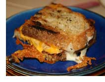 Delicious grilled cheese sandwich on blue plate