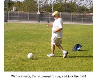 Danny kicks a ball