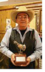 Photo of Jerry Wallace with this award