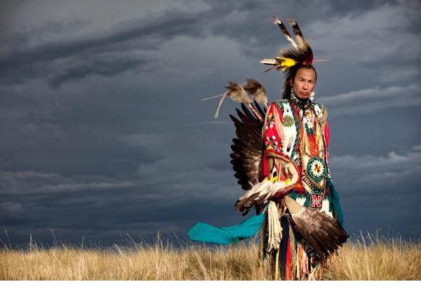 Native American on the plain in full regalia