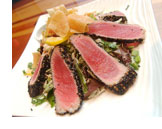 Beautiful slices of seared ahi tuna on a platter
