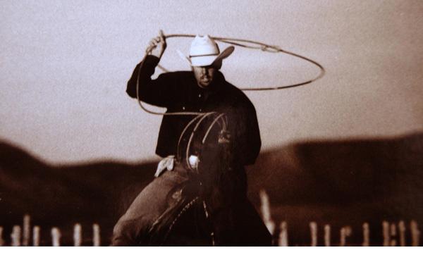 Beck photo of cowboy roping
