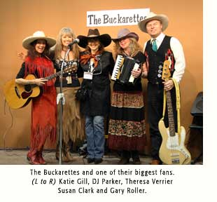 The Buckarettes and Theresa Verrier, one of their biggest fans